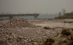The remains of the bridge over the Sesseri River supposed to connect Bizari village to the rest of the district (Image: Chintan Sheth)