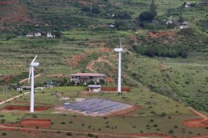 A 180-kW solar plant in Wangduephodrang district has been built next to an existing wind farm. Officials say this is the first of many such projects. (Image: UNDP Bhutan)